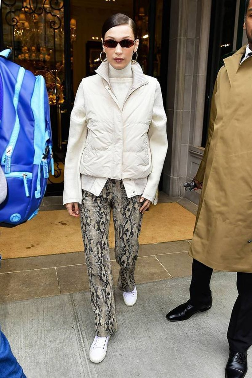 White jacket with snake patterned trousers and white shoes