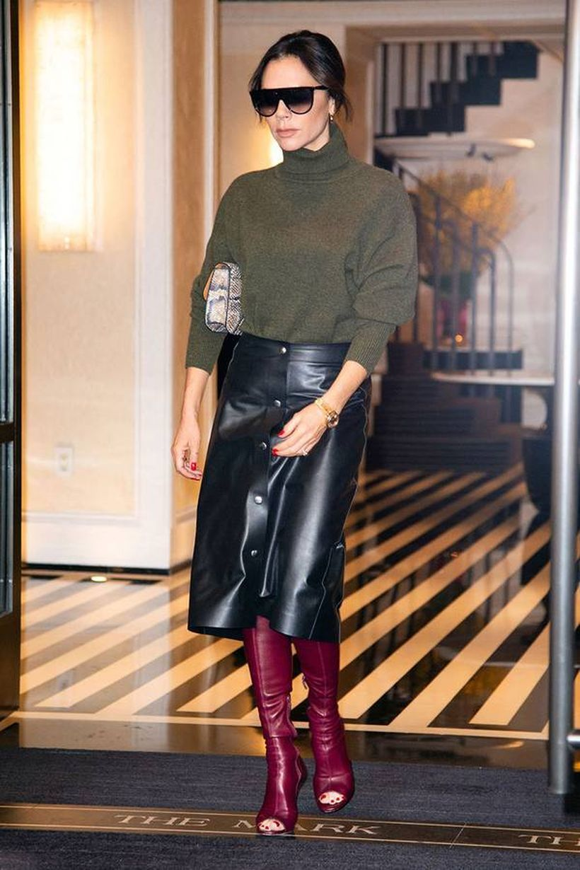 Green jacket with black short leather skirt and marron boots