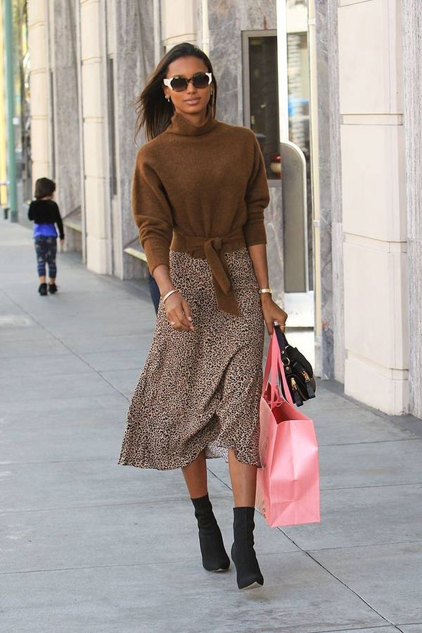 Brown jacket with leopard pattern skirt and black shoes