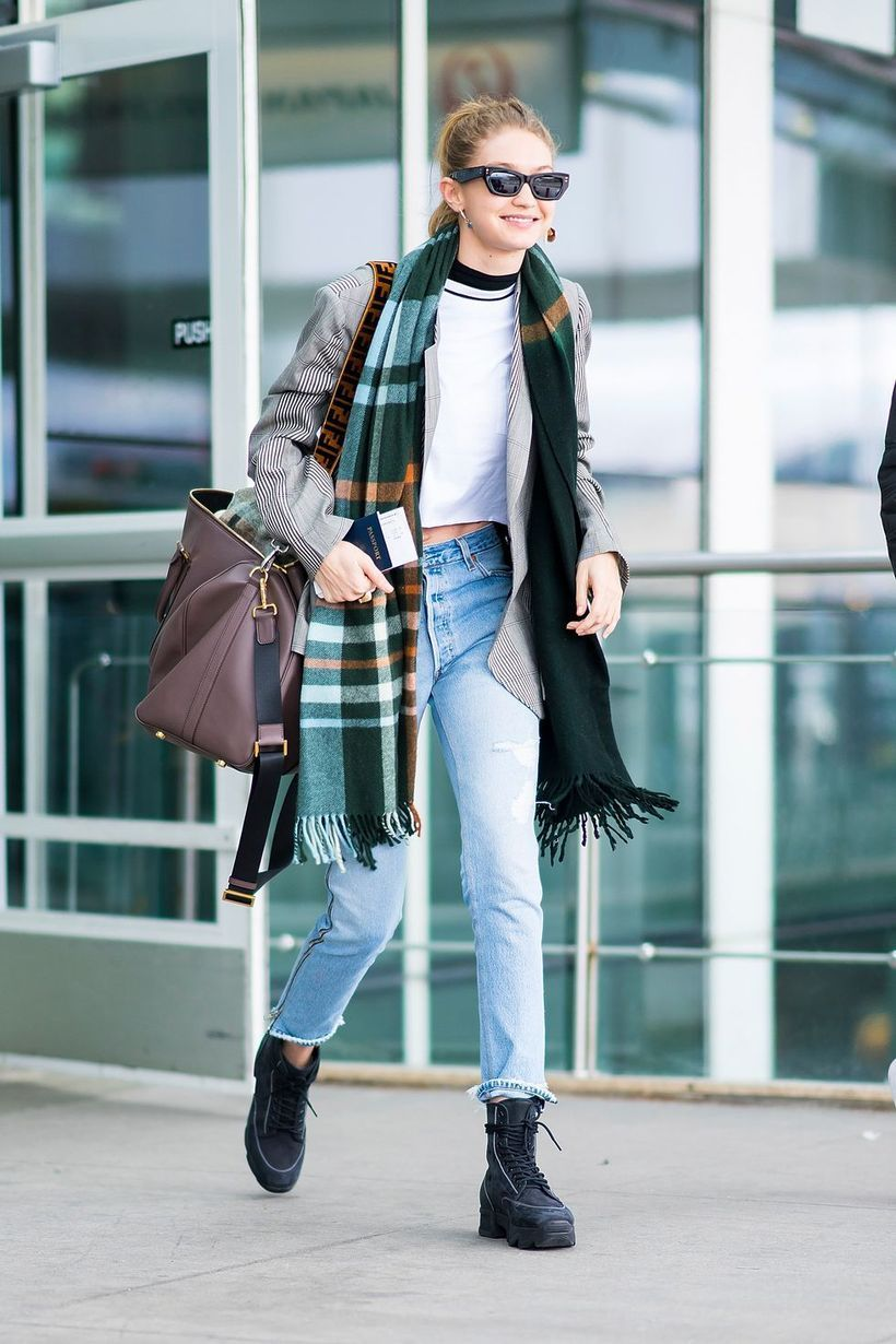 Gray outer with pattern scarf, white t-shirt, denim pants and black shoes