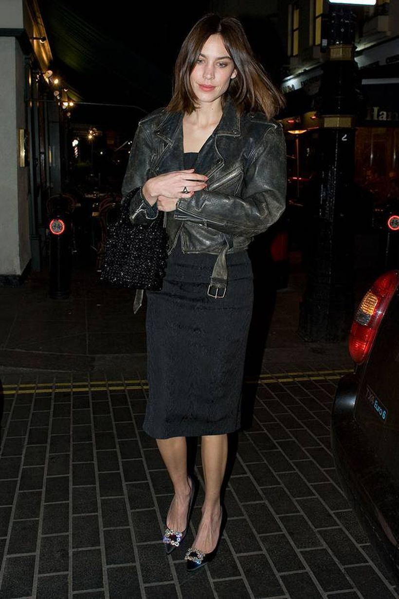 Black leather jacket with black dress and black high heels